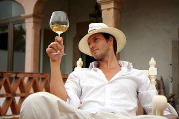 Reicher Mann im Urlaub