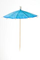 blue cocktail umbrella suspended in air.