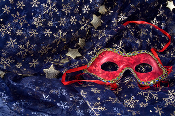 red mask on a blue background