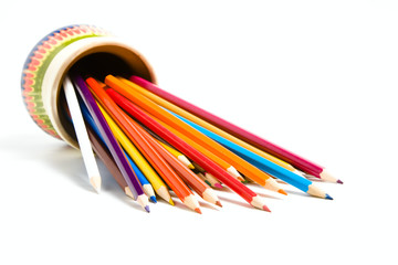 Assortment of colored pencils with shadow on white background