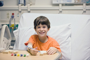 Little Boy Painting in the Hospital