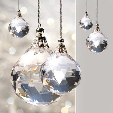 Crystal ornament hanging against shimmering background