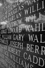 A closeup of engraved names on the Iwo Jima war memorial