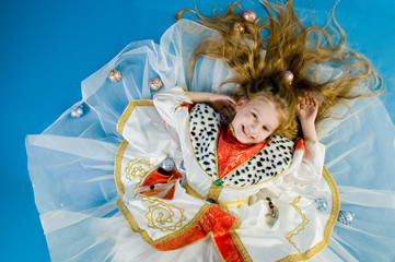 Smiling little girl in royal clothes, high angle of view