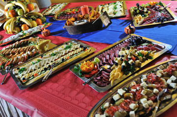 Catering fresh and teasty food at a party  on big table