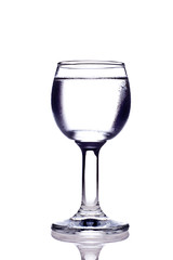 glass with vodka on white background