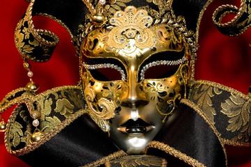 Ornate handmade venetian mask on red background