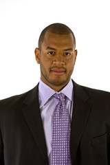 A black man in a nice business suit and purple shirt and tie