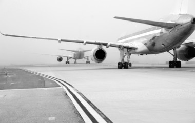 Planes on foggy runway