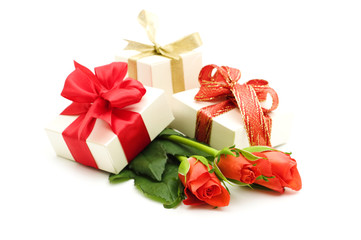 red roses and gift box on white background