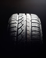 Brand new winter tire pattern on black background