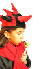 Girl with funny red black hat and wooden toy