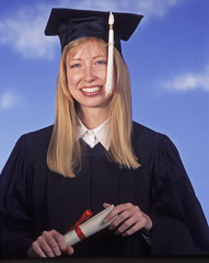 a university graduate holds her diploma