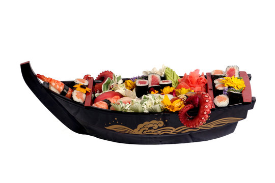 Sushi with octopus on black plate boat