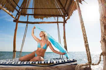 Beautiful young woman relaxing near the sea