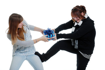 sisters fighting over a present