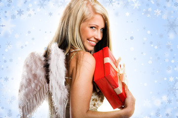 smiling beautiful blond angel with a gift and snowflakes
