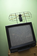 Old TV set, noisy picture, aerial.