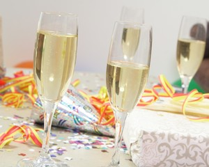 Glasses of champagne and gifts at a party