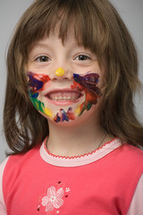 little girl with paint on face
