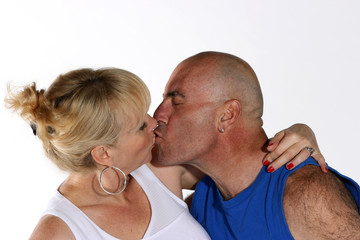 Mature man and woman in sportswear kissing
