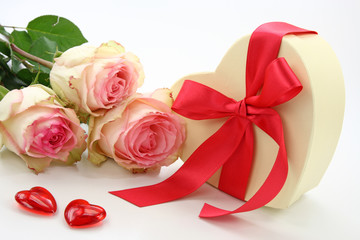Gift box and roses isolated on white background