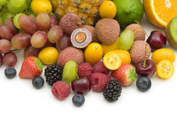exotic fruits and berries on white background