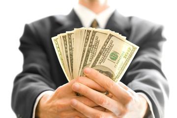 money in hand of businessman