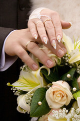 Hands and wedding flowers