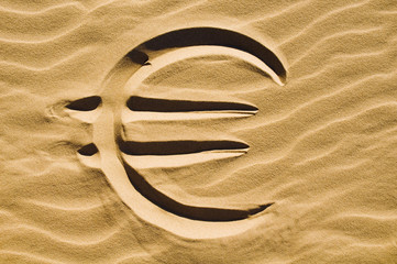 Euro sign in the sand