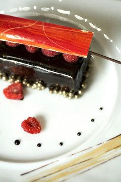Dark chocolate tart with raspberry wafer