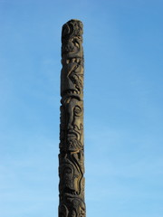 Totem pole on blue sky background 1