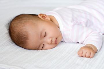 Baby girl asleep on her tummy