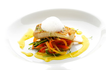Trout fillet with lemon cream on different vegetable