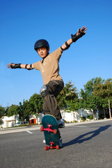 Boy Doing Stunts on a Skateboard