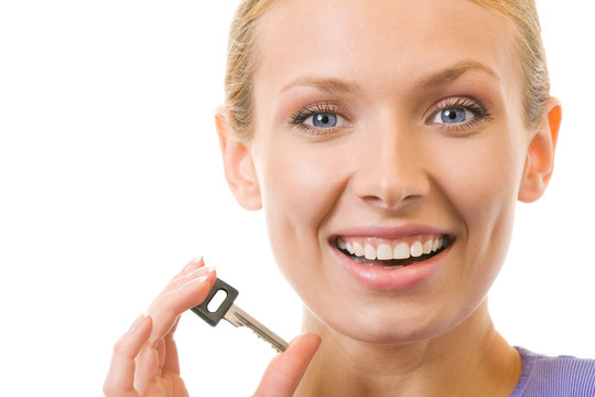 Young happy woman with key, isolated on white
