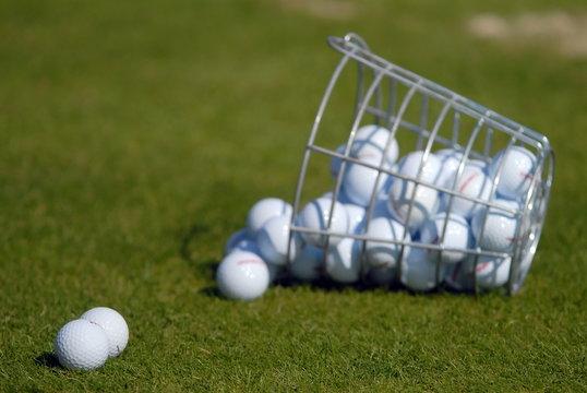 Fallen basket with balls for golf