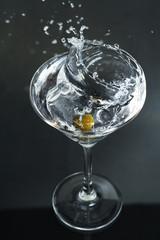 Splash in glass of martini
