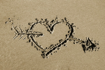 Heart and arrow - drawing in sand