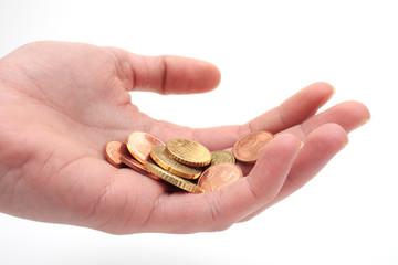 Hand mit Kleingeld