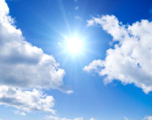 Sun is glowing between clouds