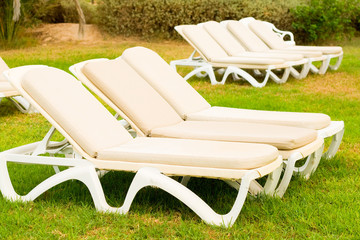 beds for sunbathing on grass