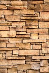 Vertical image of flat stone wall texture