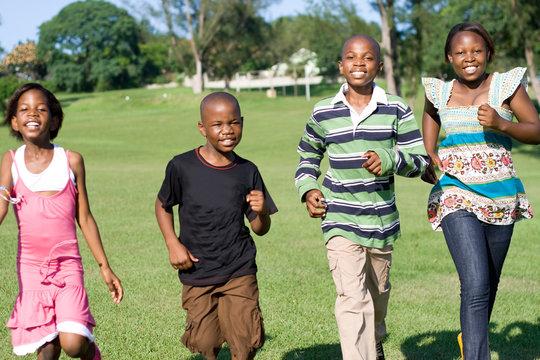 african children running in the park towards camera