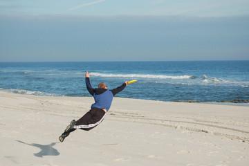 Frisbee Player on Beach