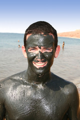 man with mud at the dead sea / Jordan