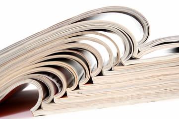 heap of open magazines