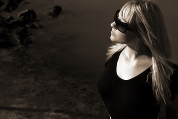blond german girl at the black stones BW - sunglasses shades -