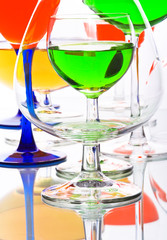 abstract composition with wine glasses with coloured liquids
