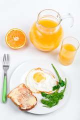 breakfast meal with fried egg and a jug of orange juice